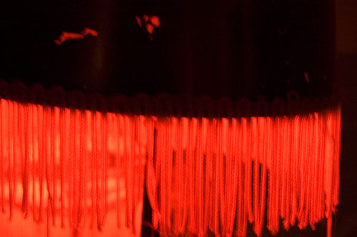Red Fringe on Glowing Lamp